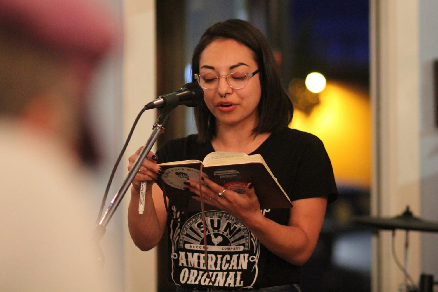 Veronica Murray performing her own poetry at The Mason Jar's open mic night