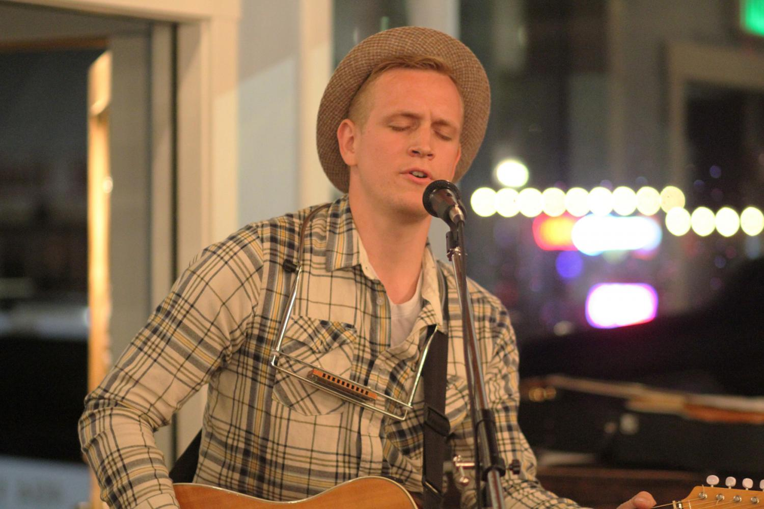 Michael Boucher performing a cover at The Mason Jar's open mic night