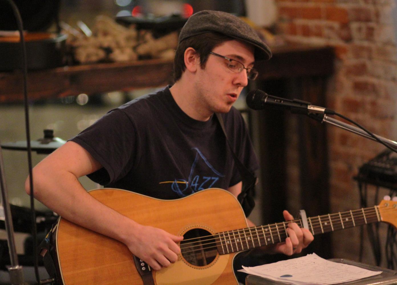 Brian Rebar performing at The Mason Jar's open mic night