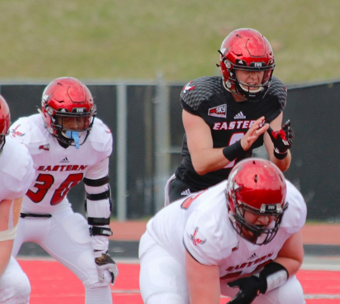Running back Tamarick Pierce (30) and quarterback Gage Gubrud (8) in the backfield, at the Red-White spring game.