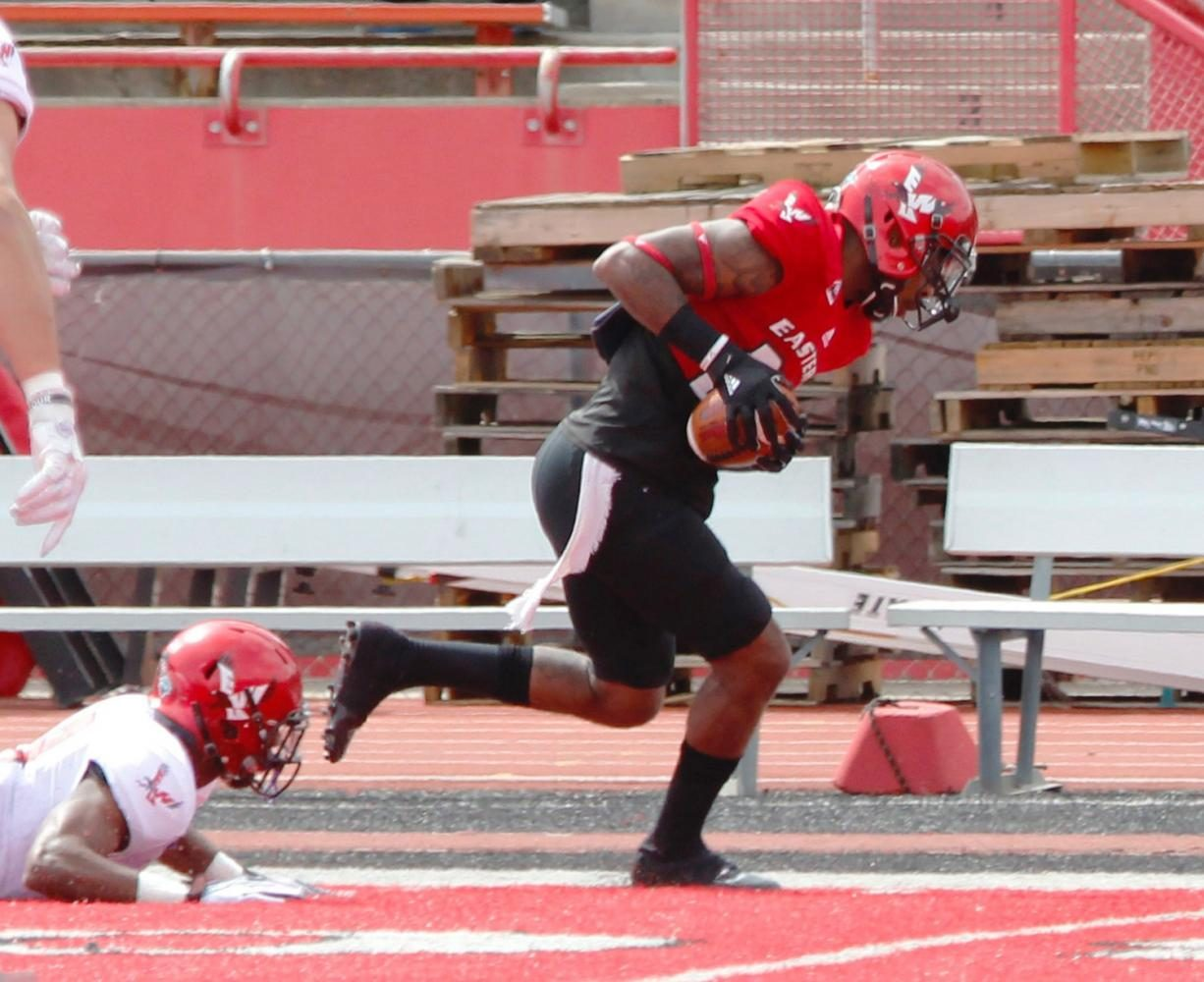 Wide receiver Keonte White (25) makes a catch over defensive back Josh Lewis (19), at the Red-White spring game.