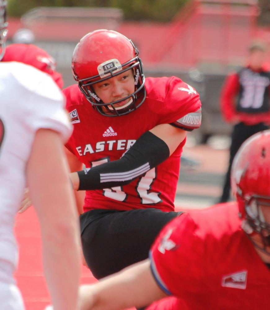 Kicker Roland Alcobendas (62) with the PAT, at the Red-White spring game.