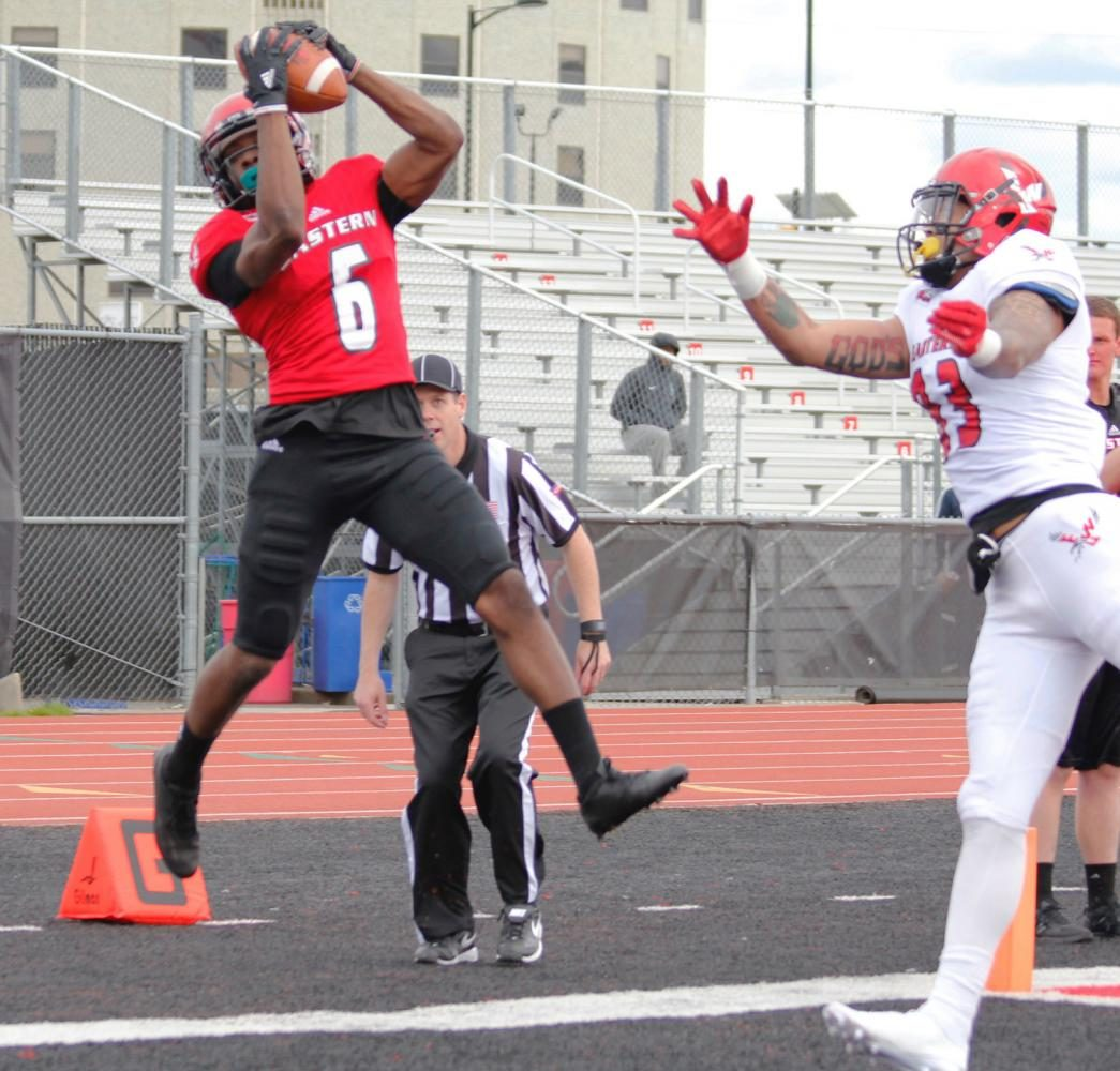Defensive back Nzuzi Webster (6) intercepts the pass in the back corner of the end-zone, at the Red-White spring game.