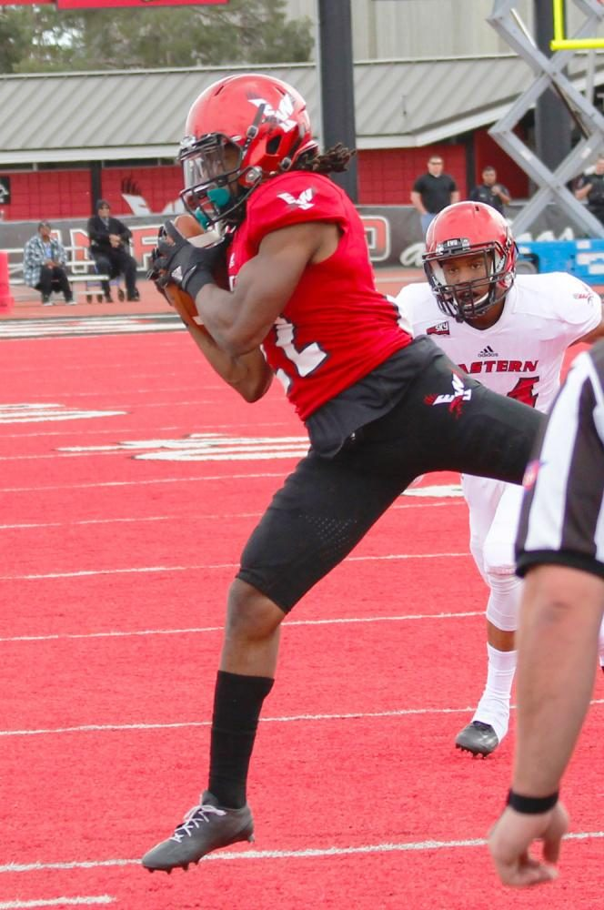 Wide receiver Nsimba Webster (22) makes a catch along the sideline, at the Red-White spring game.