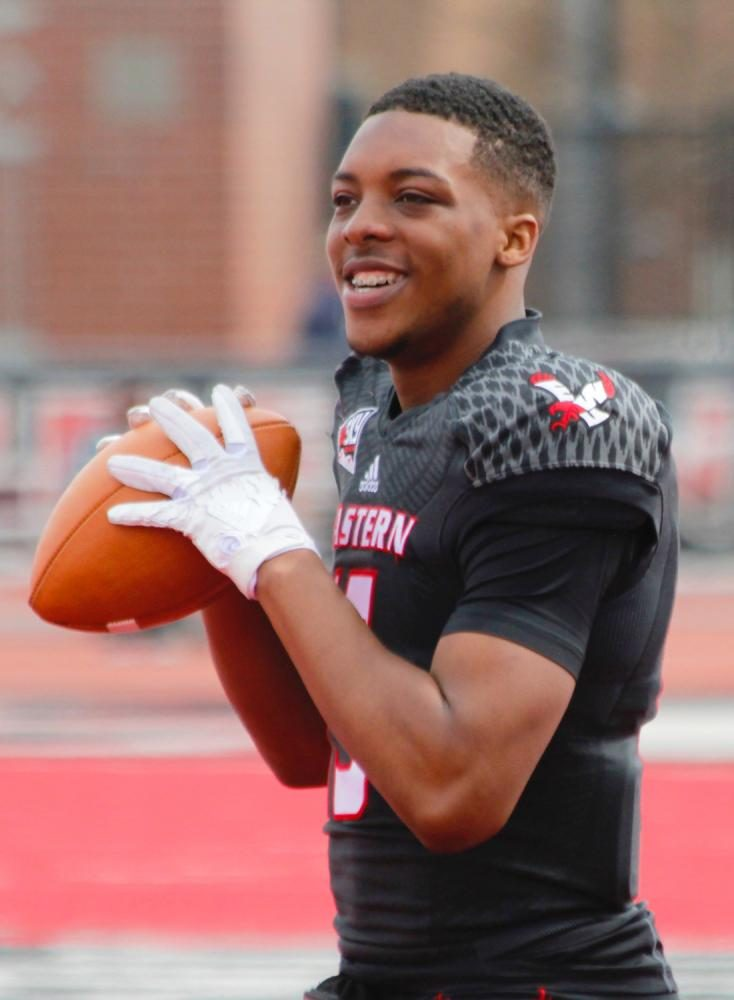 Quarterback Eric Barriere (15) playing catch during halftime, at the Red-White spring game.