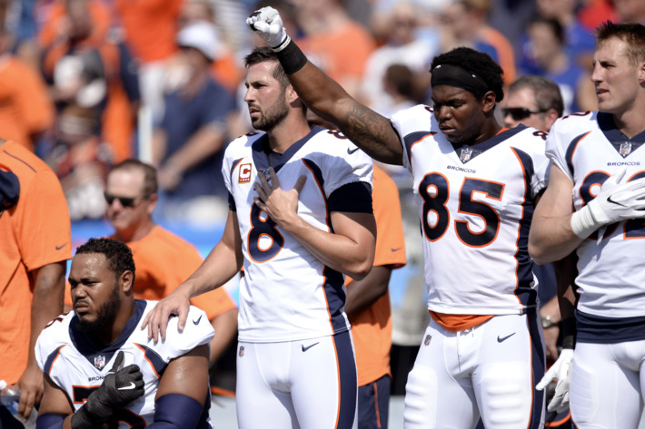 Denver Broncos tight end Virgil Green raises his fist in the air during the national anthem. | Photo courtesy of AP's Adrian Kraus