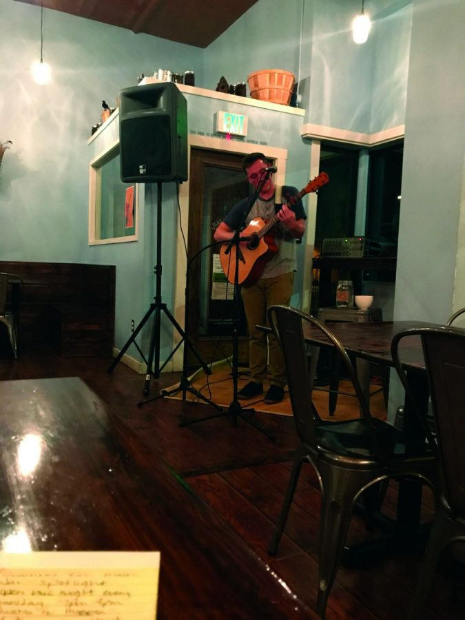 Jamison Sampson playing his guitar on open Mic night. Sampson has been apart of open night since last year   Sam  Jackson for The Easterner