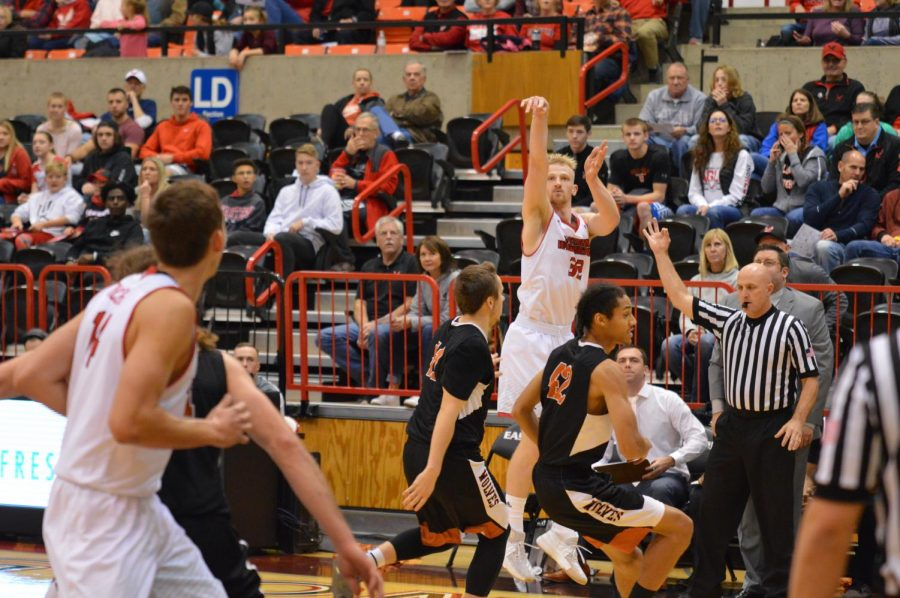 Senior forward Bogdan Bliznyuk shoots a three-pointer against Walla Walla University on Nov. 10. Bliznyuk was named a Big Sky Conference Player of the Year Candidate   Bailey Monteith for The Easterner