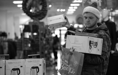 A shopper looks for deals on Black Friday in Seattle. An estimated $682 billion was spent on Black Friday in 2017 | Photo courtesy Associated Press/Elaine Thompson