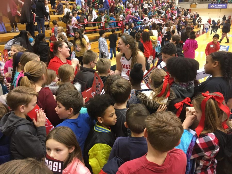 Senior forward Delaney Hodgins signs autographs after EWU's victory on Kid's Day. Hodgins is averaging 19.5 points and 7.4 rebounds for the Eagles. | Jeremy Burnham for The Easterner.