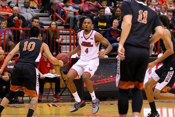 Senior guard Sir Washington surveys the defense against Walla Walla on Nov. 10. Washington had nine points and five rebounds in the team's loss to Northern Colorado. | Photo courtesy of EWU Athletics.