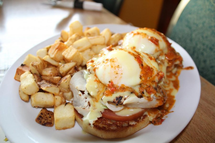 Bene's famous California Benedict and fries. It consists of two poached eggs, thin-sliced turkey, avacado, tomato, sun-dried tomato and hollandaise sauce over an english muffin | Mckenzie Ford for The Easterner