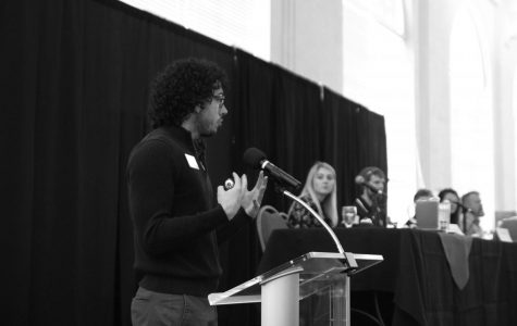 Dr. Nick Franco hosts the Diversity Dialogue talk on Jan. 29. Franco asked the panel questions on what they think the proper responses to sexual harassment might be | Andrew Watson for The Easterner