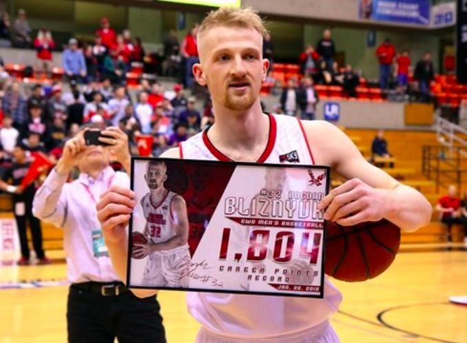 Senior+forward+Bogdan+Bliznyuk+poses+with+his+career+points+record+plaque+on+Jan.+25.+Bliznyuk+passed+former+teammate+Venky+Jois+to+become+EWU%27s+new+all-time+leading+scorer.+%7C+Photo+courtesy+of+Ron+Swords