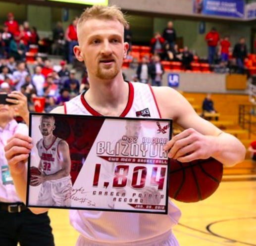 Bogdan Bliznyuk poses with his career points record plaque on Jan. 25. | Photo courtesy of Ron Swords