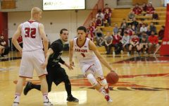 Former men's basketball player Tyler Harvey uses a screen from teammate Bogdan Bliznyuk in 2014-15. Harvey currently plays professionally in France for the Antibes Sharks   Photo courtesy of The Easterner Archives