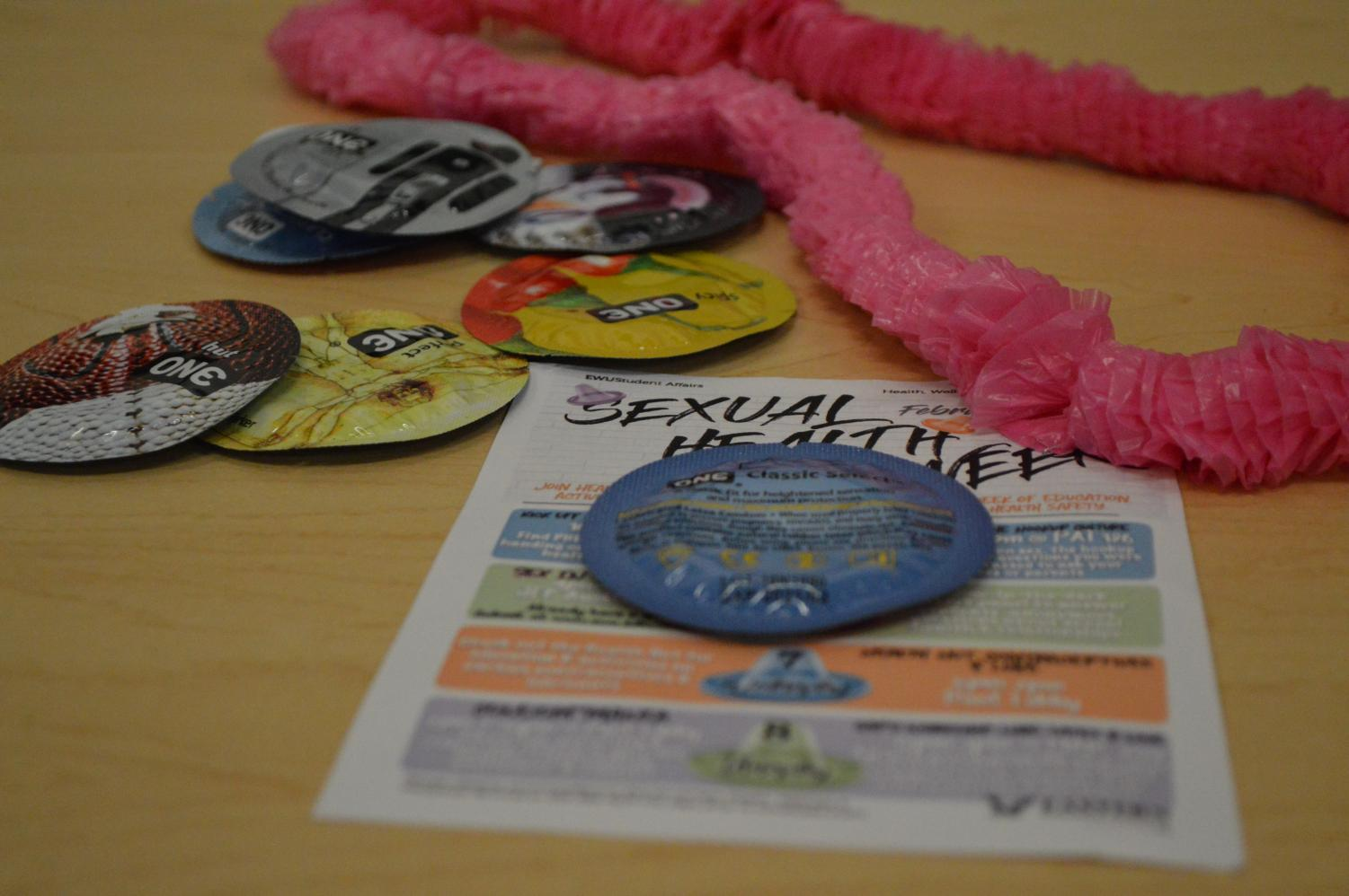 Condoms and flyers at the Condomania event held by EWU's Health and Wellness | Sam Jackson for The Easterner