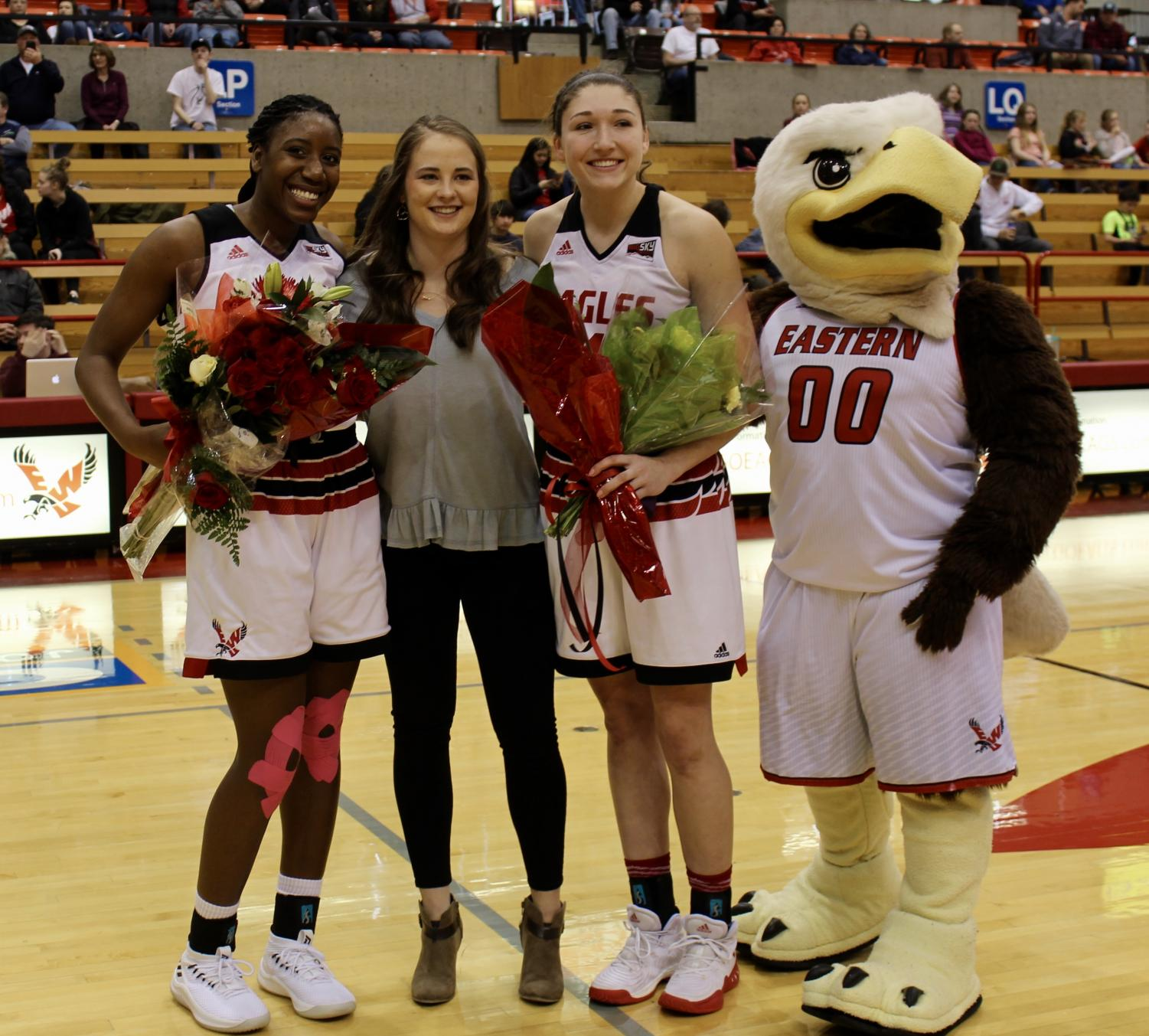 (left to right) Senior forward Mariah Cunningham, senior team manager Sarah Kroontje and senior forward Delaney Hodgins pose with Swoop before the EWU women beat Idaho State 66–64 on Feb. 24. The Eagles are in a four-way tie for third place in the Big Sky with two conference games remaining | Mckenzie Ford for The Easterner