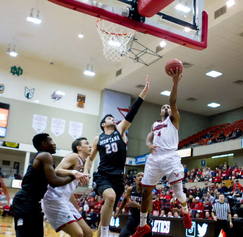 Senior guard Sir Washington extends for a layup in EWU's win over Montana on Feb. 15. Washington is averaging 8.5 points per game in Big Sky Conference play   Richard Clark IV for The Easterner