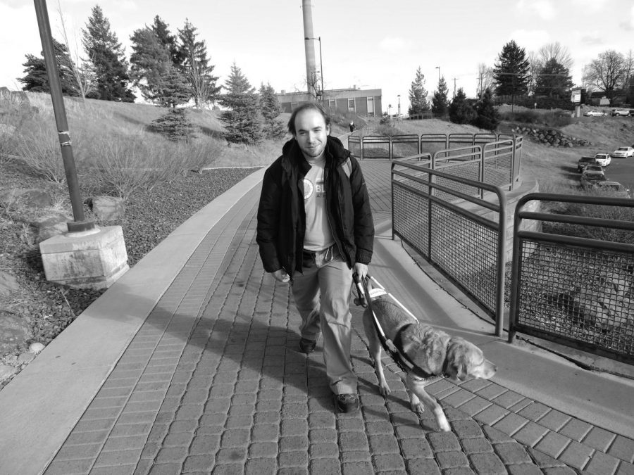 Timothy+%22TJ%22+Breitenfelt+walks+around+campus+with+Roxanna%2C+his+service+dog.+Breitenfelt+is+mostly+blind%2C+and+has+to+rely+on+EWU%27s+Disability+Support+Services+to+get+through+school+%7C+Photo+courtesy+Rebecca+Pettingill