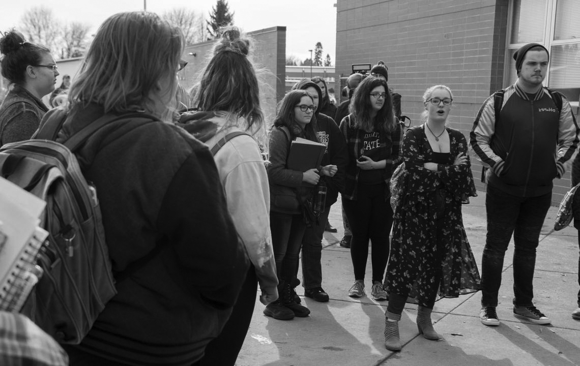Students at Cheney High School hold a rally outside by the front doors. They, along with students all over the country, have staged walkouts protesting gun violence and school shootings | Photo courtesy of the Spokesman-Review