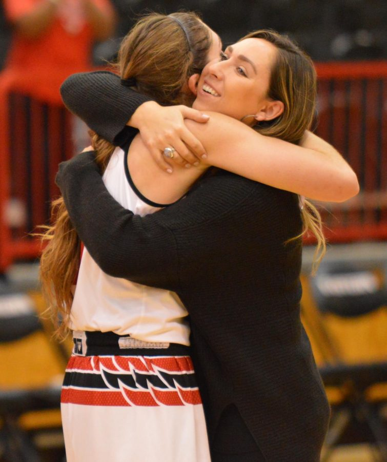 Hodgins sisters, Delaney (left) and Hayley (right), embrace after Delaney broke Hayleys EWU career scoring record on Feb. 1. Delaney is averaging 20.8 points, 7.5 rebounds and 2.3 assists in her senior season | Bailey Monteith for The Easterner