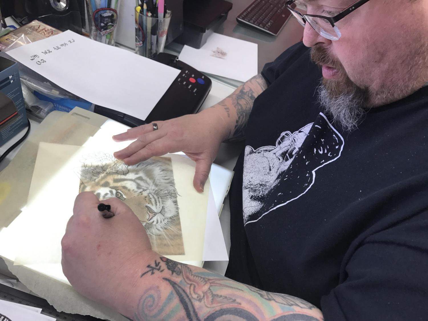 Owner of All-American Tattoo, Tom Morris, working on a Tiger tattoo sketch. All American Tattoo has been in business for 10 years | Sam Jackson for The Easterner