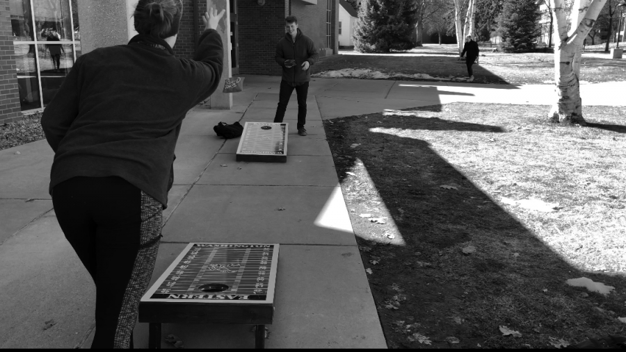 Students play corn hole outside Tawanka. March is National Nutrition Month and this week EWU is celebrating Nutrition week | Josh Fletcher for The Easterner