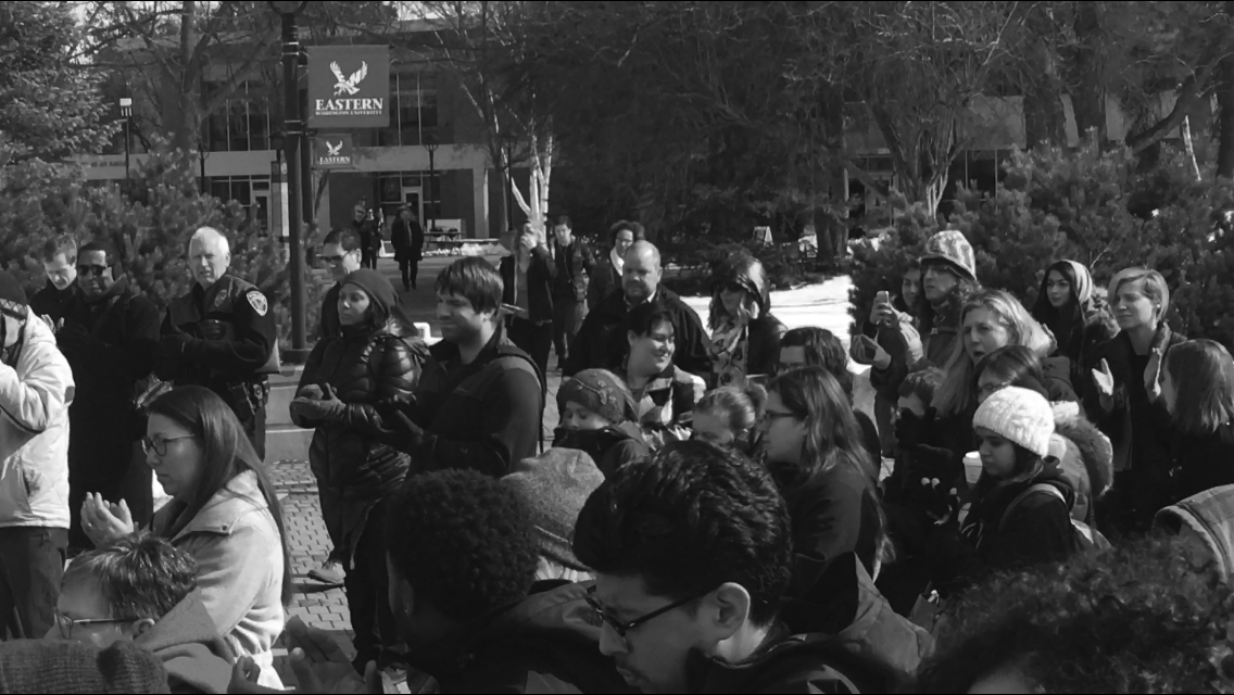 Students gather at the Campus Mall to speak out against racist flyers posted around campus. The unity Rally was to show that EWU dopes not stand for hate and discrimination | Jeremy Burnham for The Easterner