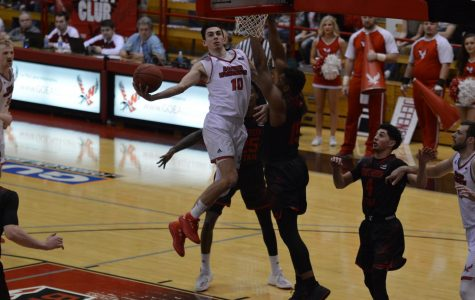 Redshirt freshman guard Jacob Davison hangs in the air for a layup against Southern Utah on March 1. Davison is one of seven major players returning for the Eagles next season | Bailey Monteith for The Easterner