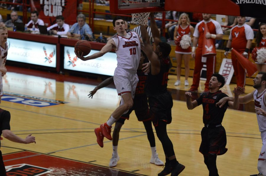 Redshirt freshman guard Jacob Davison hangs in the air for a layup against Southern Utah on March 1. Davison is one of seven major players returning for the Eagles next season   Bailey Monteith for The Easterner