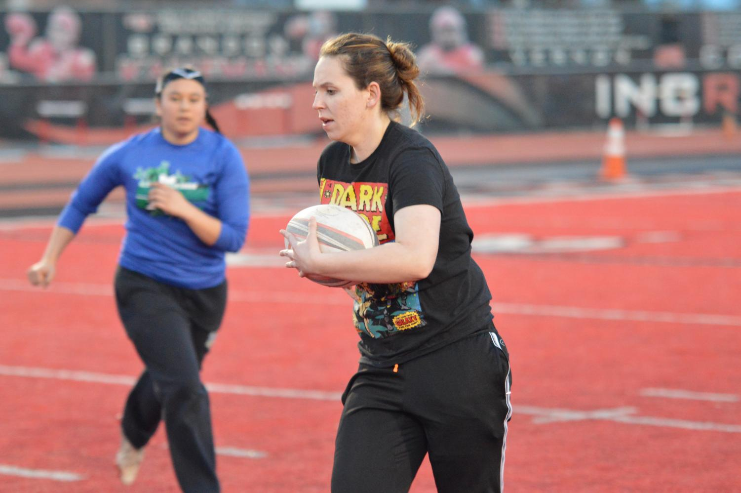 Junior Kailey Wallis caries the ball during practice on April 9. Wallis, who is one of the team's captains, said rugby is