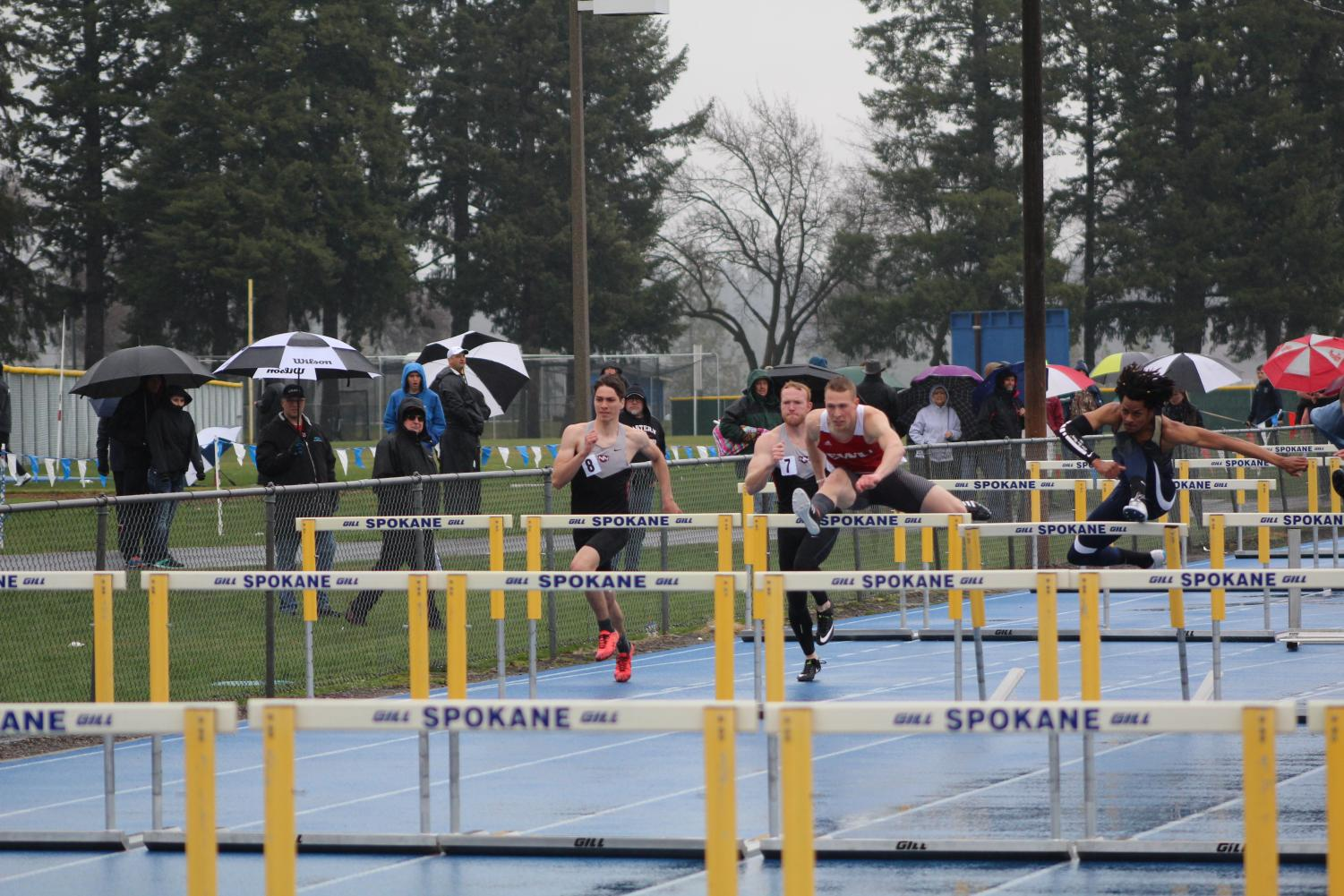 Junior runner Parker Bowden Jr. participates in the 110-meter hurdles at the War XI in Spokane Falls Community College on April 7. Bowden placed second in the event with a time of 14.74 seconds, just .01 seconds behind the first place runner | Mckenzie Ford for The Easterner