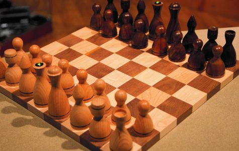 EWU alum Steve Whitford's wooden chess set that he carved. Whitford is now concentrating on creating usable art and small furniture in his wood shop | Photo courtesy of Tori Bailey