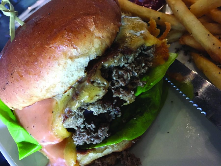 Cascadia Public House offers a vegetarian, meat-like hamburger that contains heme. The Impossible Burger, was developed by Dr. Pat Brown of Impossible Foods | Jeremy Burnham for The Easterner