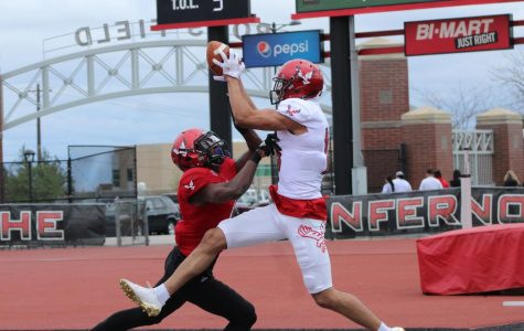 Redshirt freshman wide receiver Andrew Boston catches a touchdown pass at EWU's annual Red-White spring game on April 28. Boston's White team won the friendly matchup 17–0 | Mckenzie Ford for The Easterner