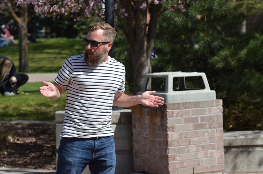 Preacher Keith Darrel talks to a crowd of students outside of the JFK Library. Darrell's unconventional style of preaching Christianity draws him plenty of attention when he preaches at college campuses around the region | Bailey Monteith for The Easterner