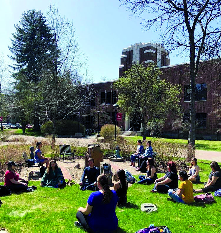 Lectureer Mary WardLupinaxxi teaches her Children's Studies 325 class April 25 n the EWU Meditation Garden | Photo courtesy of Mary Ward Lupinacci