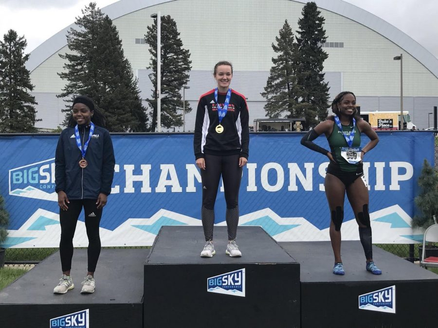 Senior Rebecca Tarbert (center) posing with her 100-meter first place medal at the Big Sky Championships on May 11. Tarbert, who is the first Eagle to win the event since 1994, secured the title in 11.64 seconds | Photo courtesy of EWU Athletics