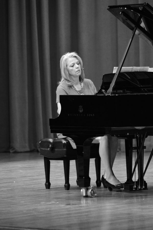 Karen Walker performing at David Rostkoski's memoral concert. Rostkoski requested that his students from the 1980s, Karen Walker and Jody Graves, to perform at his concert   Bailey Monteith for The Easterner