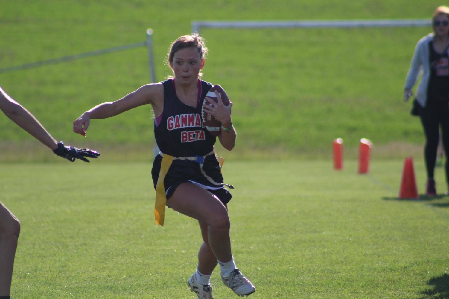 Gamma Phi Beta President Ali Blanton, evades a flag puller. Flag football was one of the highlights of Greek Week | Mckenzie Ford for The Easterner