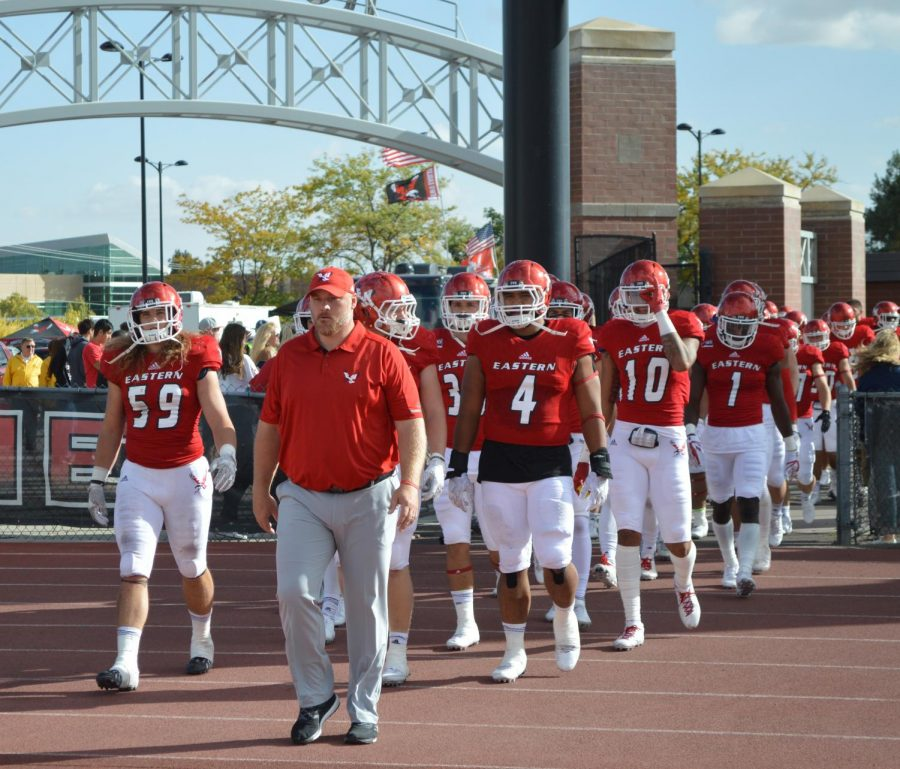 Head football coach Aaron Best leads the football team out after halftime against Weber State last season. Best has been a part of the Eagles' last eight Big Sky Championships - one as a player and seven on the coaching staff | Bailey Monteith for The Easterner