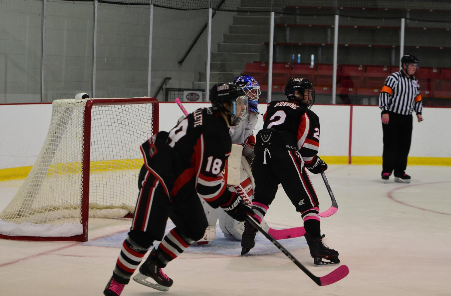 Two hockey club members in a game against Washington State this season. The club recently joined the Pac-8, a Division II conference in the American Collegiate Hockey Association | Photo courtesy of EWU Hockey Club