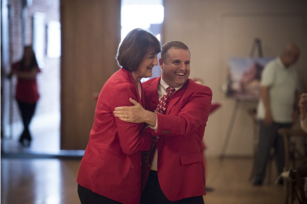 Athletic Director Lynn Hickey and Provost Scott Gordon embrace during the public announcement of EWU's new Strategic Plan. The plan was developed over almost a year of research and community input | Photo courtesy of EWU Marketing Communications