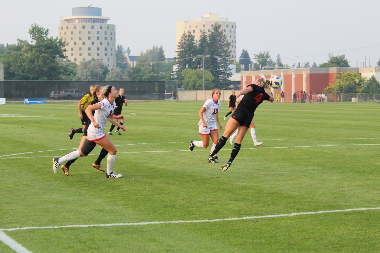 Senior forward Allison Raniere heads the ball against South Dakota on August 24 | Jeremy Burnham for The Easterner
