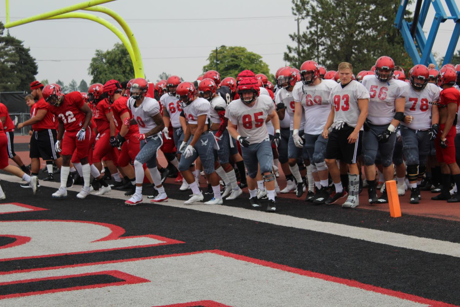 The EWU football team takes the field before its scrimmage on August 25 | Jeremy Burnham for The Easterner
