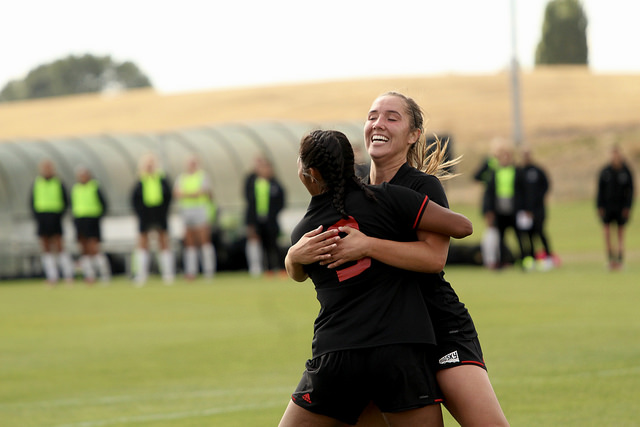 Allison Raniere (facing the camera) celebrates with Jenny Chavez after the two seniors connected on a goal. The goal ended a scoring drought of 262 minutes for the Eagles | Mckenzie Ford for The Easterner