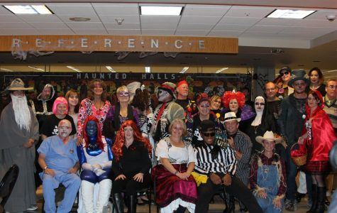 Attendees pose during the 2016 edition of Oktoberfest. The 2018 version will be at JFK Library on Oct. 20 and will be fairytale themed.