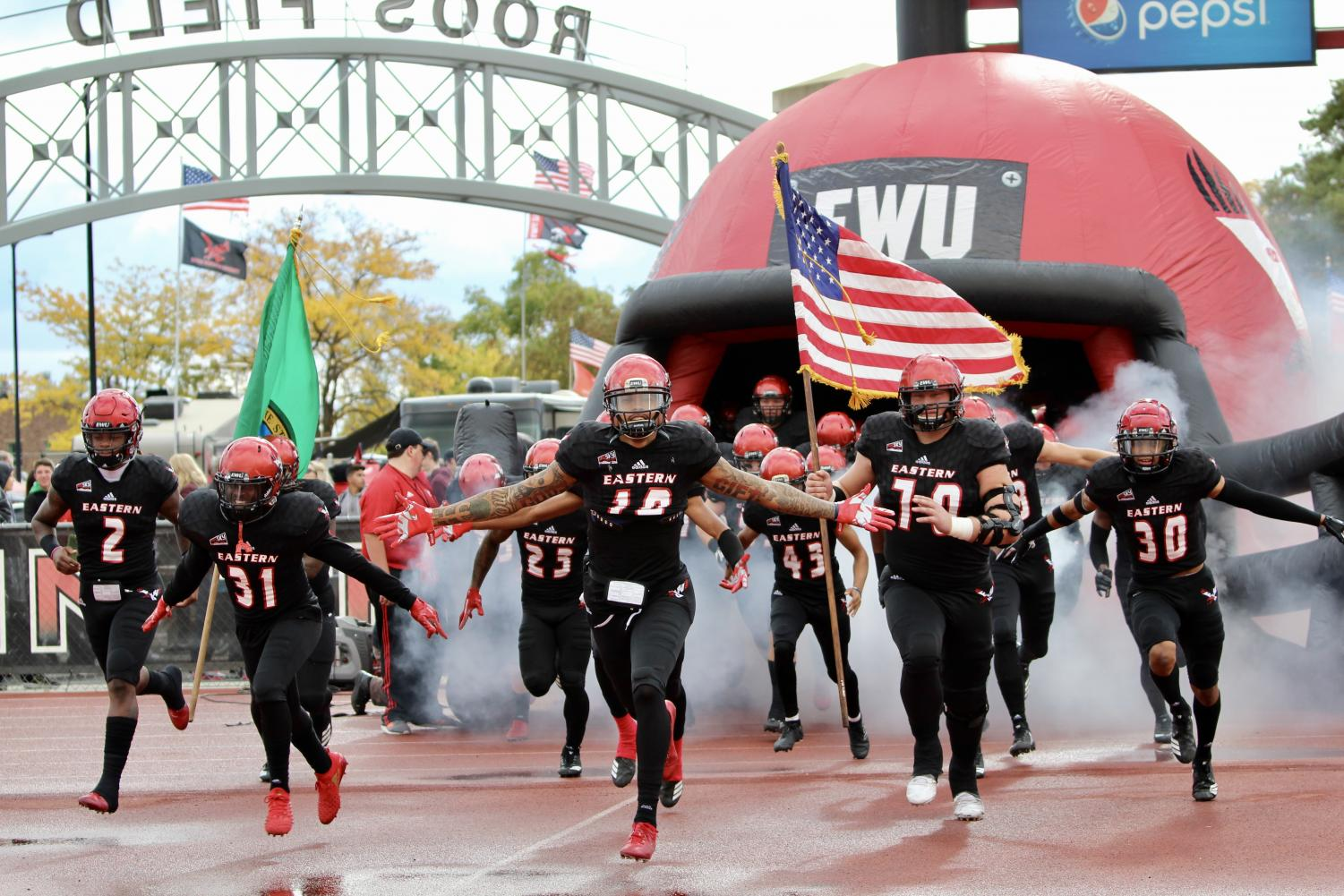 The EWU football team enters Roos Field on Oct. 6, 2018 before a victory over Southern Utah.