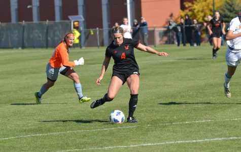 Senior Allison Raniere kicks the ball during Sunday's  victory over Idaho State. Raniere was one of five seniors recognized during senior day. | Bailey Monteith for The Easterner